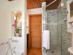 Bathroom has shallow tub perfect for children and a lux shower for adults.