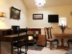 Lounge has desk and wood burning stove