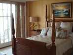 Spacious master bedroom with walkout to deck with full view of the ocean