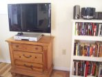 Flat screen t.v., hundreds of dvds and books.