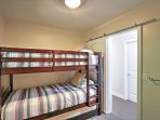 Bunk beds offer additional sleeping space.