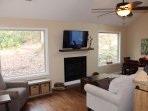 Comfortable living area with gas fireplace and satellite TV.