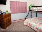 Bunk bed room with double and twin beds.