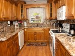 Large kitchen with thick 2inch granite counter tops.