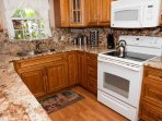 Gorgeous kitchen with 2inch thick granite counter tops and oak cabinets.