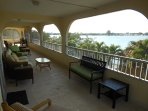 Screened in balcony on Family room floor with great view