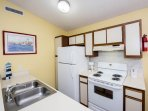 Full size stove, fridge, coffee maker, toaster, and all the other kitchen amenities