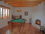 Pool table room with pool table, round bart table & bar stools + gas log fireplace for added ambiance !