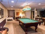 The billiards table and game table offer some additional fun in the apartment!