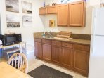 Kitchen has microwave, large toaster oven, hot plate, rice cooker, blender, and coffee maker.