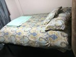 Queen bed with down comforter and all cotton 600 thread count sheets