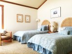 Upstairs bedroom with partial ocean view