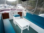 Large comfortable Flybridge with clears all around that protect from any weather
