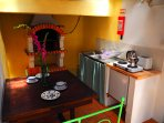 Kitchen w/fridge, hobs, kettle, toaster, kitchen utilities and barbecue