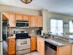 You'll love preparing home-cooked meals in the fully equipped kitchen.