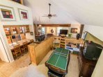 An aerial view of the condo. This mountain-style home has been well-maintained and offers Guests an authentic feel with...