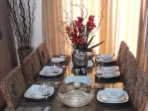 6 seat dinning table with cushioned chairs