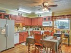 Enjoy a meal cooked in this fully equipped kitchen.