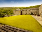 Shared bowling green with the hills of Monsal Dale in the background