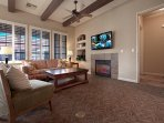 Comfortable Living Room with Fireplace, Ceiling Fans, Flat Screen TV