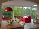 Living and dining areas with stunning tree-top views