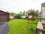 Private backyard/patio with park benches