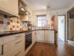 A spacious kitchen with extensive worktops