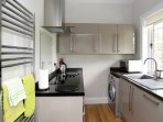 Fully fitted kitchen with dish washer, washer/dryer, microwave, fridge/freezer.