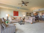 Living Room features queen sleeper + love seat and 2 armless side chairs