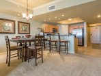 Dining area includes raised breakfast bar for additional seating
