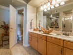 Master bath features double vanities and private toilet closet