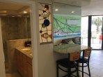 Jack/Jill Master Bath has a hand custom made stain glass fish window.
