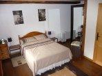 Large bedroom with plenty of storage.