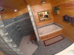 Master bath with double walking shower and Jacuzzi Tub