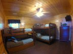 Lower bedroom with full bunk and twin bunk with trundle. Has its own full bath with shower/tub combo