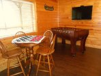 Foosball table, seating table and new 43' HD TV