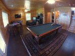 Game room on lower level with 8' pool table, foosball table, new arcade machine, Gaming TV