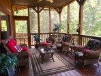 Screened porch on lower level with all the comfort seating to enjoy and relax