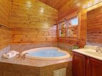 The upstairs private bath with heart shaped jacuzzi