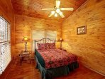 The second floor queen bedroom with plenty of windows and views of Mt. Leconte