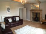 lounge with gas fire, TV, DVD, CD, Wifi. Seating for 4 people.  Selection of books and board games.