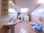 Bathroom with laundry facilities