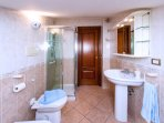 Bathroom with shower, toilet and bidet