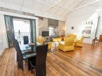 Spacious living/dining room, vaulted ceiling, in historic building.