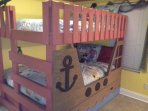 Double bunkbeds in the 'pirate room' with pullout twin trundle -- sleeps 5!