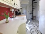 Enjoy the new quartz counters and granite sink! Spiral stairs are fun!