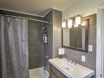 The full bathroom has everything needed to appease your bathing needs.