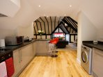Large kitchen with dishwasher, washer/dryer, freezer and quality appliances and ample crockery.