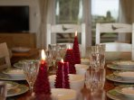 Fine crockery & crystal glasses. Large dining table for guests to eat together
