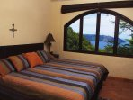 Upstairs bedroom with a King bed and a splendid ocean view